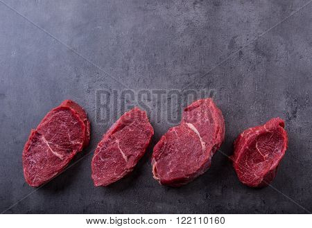 Steak. Raw beef steak. Fresh raw Sirloin beef steak sliced or whole ready for BBQ or grill.