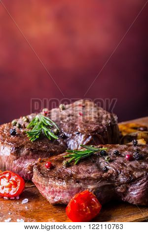 Steak. Grill beef steak. Portions thick beef juicy sirloin steaks on grill pan or old wooden board.