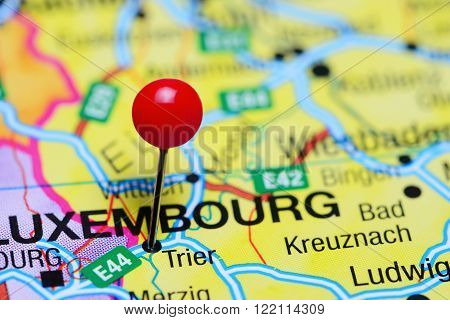 Photo of pinned Trier on a map of Germany. May be used as illustration for traveling theme.