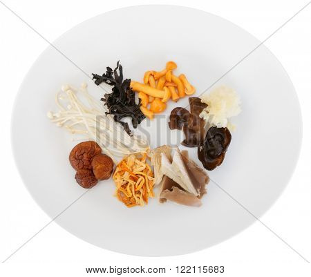 Asian mushrooms on plate, isolated over white with clipping path