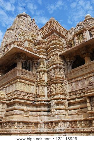 Hindu temple with stone carved erotic bas reliefs in Khajuraho India. Unesco World Heritage Site.