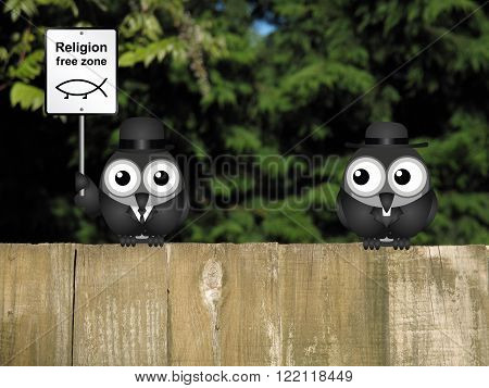 Comical religion free zone sign with bird vicar perched on a timber garden fence against a foliage background