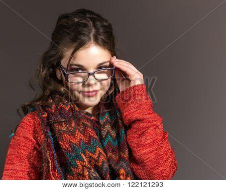 Cute fun and stylish caucasian tween girl wearing glasses