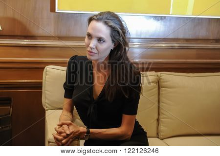 Special Envoy Of The United Nations High Commissioner For Refugees Angelina Jolie (r) During A Meeti