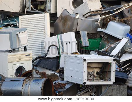 Abandoned appliances piled up in scrap yard