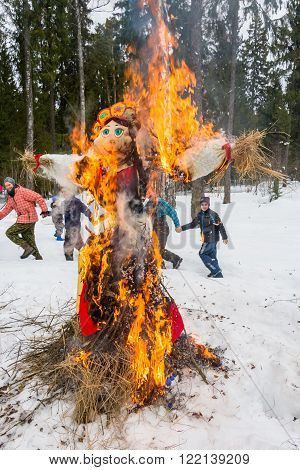 Ivanovo, Ivanovo region, Russia - March 13, 2016: Merry dance around the burning effigy of Maslenitsa spring festival on Seeing the Russian winter, 13 March 2016, Ivanovo, Ivanovo region, Russia.