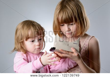 Two Girls Are Playing With Virtual Reality Glasses