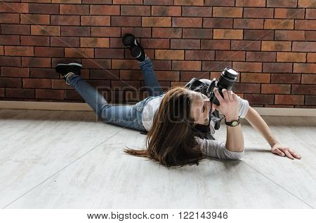 smiling girl taking photo with dslr camera in funny positions ** Note: Visible grain at 100%, best at smaller sizes