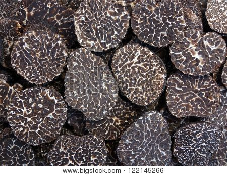 close up of sliced black truffles showing texture