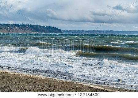The normally placid Puget Sound is filled with whitewater on a windy day.