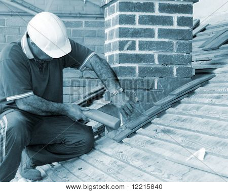 Close-up of trainee roofer on mock building site