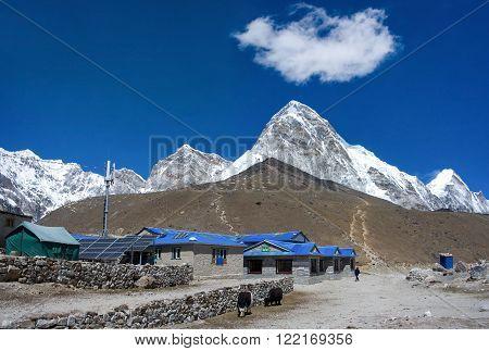 GORAK SHEP, NEPAL-MARCH 16: Gorak Shep village and Kala Patthar and Mt. Pumori (Pumo Ri). Everest region, Nepal on March 16, 2014