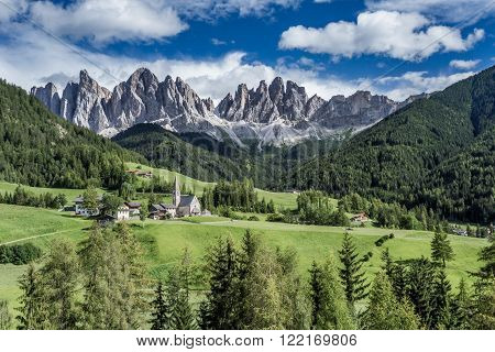 The mountain village and church of St. Magdalena (Santa Maddalena) in the Villnösstal (Val di Funes) in South Tyrol in Italy with in the background the Geisler (Odle) dolomites mountain group. ** Note: Visible grain at 100%, best at smaller sizes