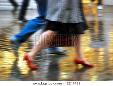 Movement effect applied to high street shoppers in rain