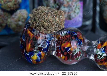 Granddaddy Purple Medicinal Medical Marijuana in colorful pipe.