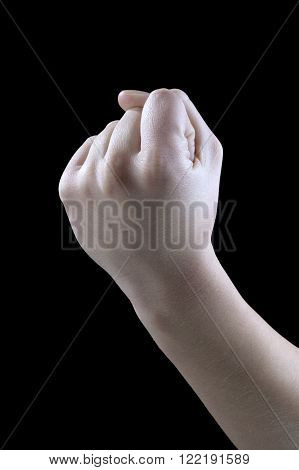 gesture threat of a fist on a black background