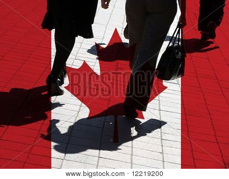 Silhouetted pedestrians overlaid with Canadian flag