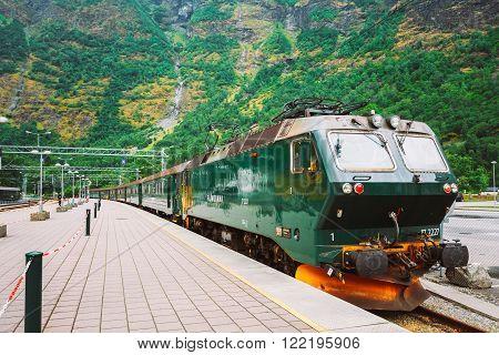 Flam, Norway - August 2, 2014: Flamsbahn In Flam, Norway. Green Norwegian Train On Railway. Famous Railroad