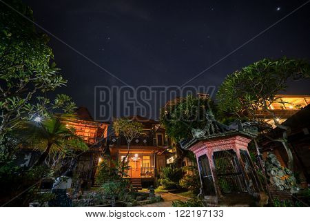 Starry night over the cottages and gardens in Ubud, Bali Island, Indonesia