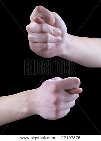 Hand gestures show the fig on a black background