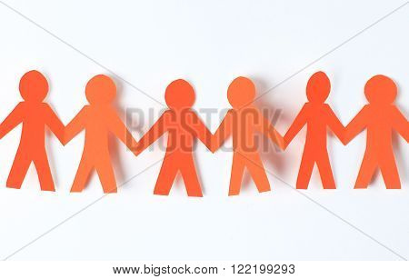 team of paper people holding hands on white background