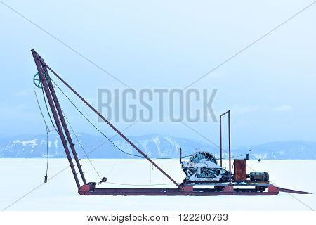 Russia Siberia. Winch for the study of ice outdoors during the winter. Science and research station on Lake Baikal. The study of the sun, the solar activity and earthquakes, seismic activity.