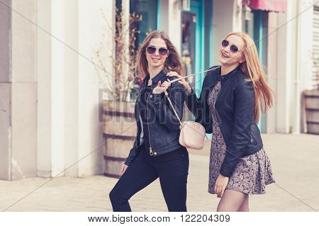 Laughing Friends On The Street In Fashion Clothes