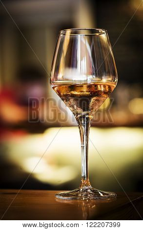 glass of spanish sherry wine on bar counter at night