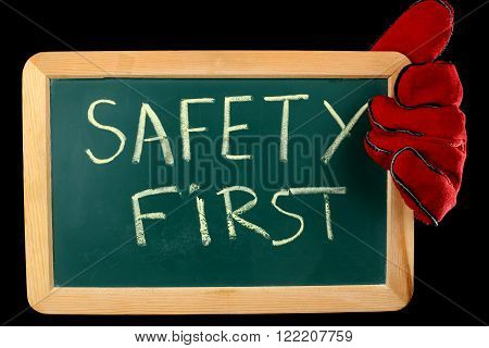 worker holding a board with the inscription SAFETY FIRST ** Note: Soft Focus at 100%, best at smaller sizes