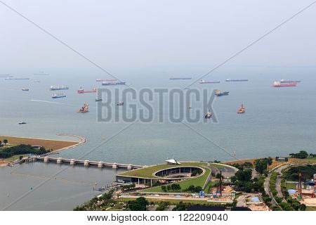 Marina Barrage dam and cargo ships lying in the roads off the coast of Singapore