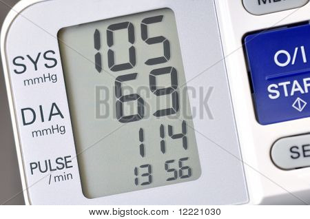 Close up of blood pressure monitor showing recent reading