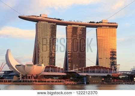 Singapore, Singapore - May 17, 2015: The hotel Marina Bay Sands at the Marina Bay in Singapore at sunset. It's a luxury resort famous for it's casino and infinity swimming pool. The hotel is one of the landmarks and tourist attractions in Singapore.