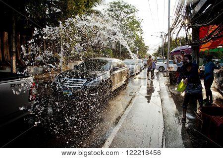 KO SAMUI, THAILAND - APRIL 13: Unidentified people shower water on Songkran Festival (Thai New Year) on April 13, 2014 in Chaweng Main Road, Ko Samui island, Thailand.