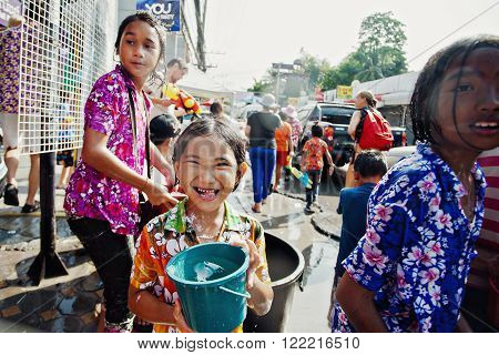 KO SAMUI, THAILAND - APRIL 13: Unidentified happy children in a water fight festival or Songkran Festival (Thai New Year) on April 13, 2014 in Chaweng Main Road, Ko Samui island, Thailand.