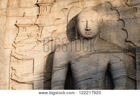POLONNARUVA, SRI LANKA - DEC 24 2015: Buddha statue face on yellow stone wall at Gal Vihariya on December 24 2015 in Polonnaruwa, Sri Lanka