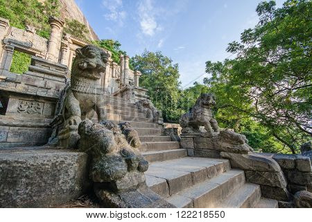 YAPAHUWA, SRI LANKA - JANUARY 17 2016: Yapahuwa was one of the ephemeral capitals of medieval Sri Lanka. The citadel of Yapahuwa lying midway between Kurunagala and Anuradhapura was built around a huge granite rock rising abruptly almost a hundred meters