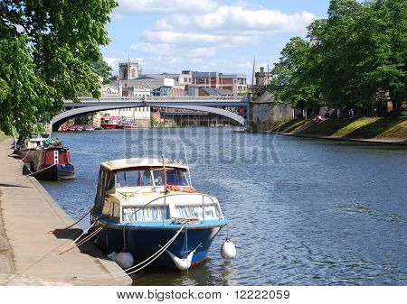 Postcard view of York showing river Ouse boats