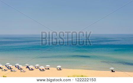Sun loungers and sun umbrella on the beach