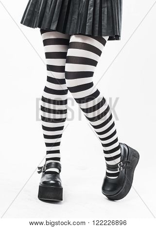 Woman legs in stripped socks isolated on white