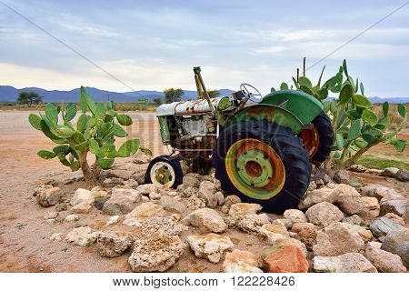 SOLITAIRE NAMIBIA - JAN 30 2016: Damaged abandoned old Fordson tractor at the service station at Solitaire in the Namib Desert Namibia. Popular touristic destination