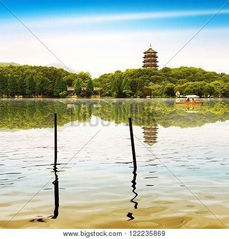 hangzhou scenerypagoda on the west lake lakefront in dusk