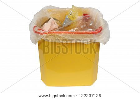 Bin with trash (Garbage bin). Yellow trash can of garbage. Isolation on a white background. Clipping path.