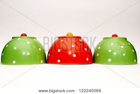 Upside down polka dot bowls with cherry tomatoes on top