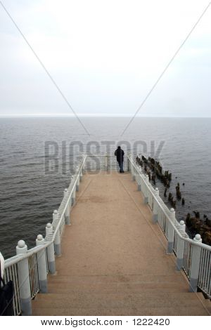 Alone Man On Sea Pier