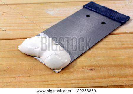 a spatula on wooden spatula with mass