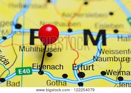 Photo of pinned Eisenach on a map of Germany. May be used as illustration for traveling theme.