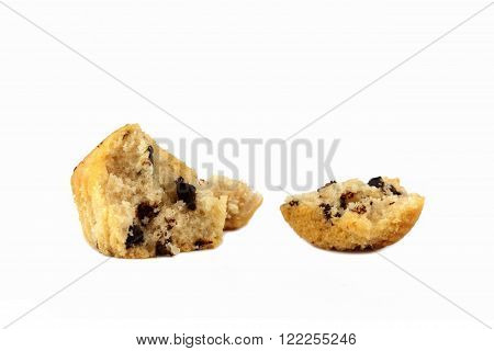 a broken muffin with chocolate on a white background