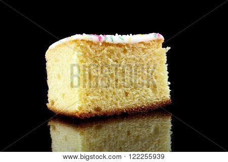 a piece of lemon cake on black background