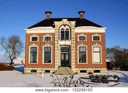 Provence of Groningen. January-17-2016. Stately farmhouse in the countryside of the Provence of Groningen. The  Netherlands