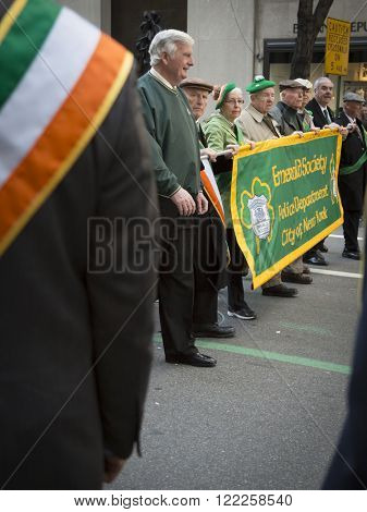 NEW YORK - MARCH 17, 2016: Members of the Emerald Society Police Department City of New York march up 5th Avenue by St Patricks Cathedral during the parade on Saint Patricks Day on March 17, 2016.